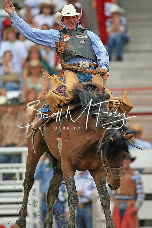 Saddle Bronc Rider Dustin Thompson scores a 71 on Whiskey Biscuit, 27 July 2007, Cheyenne Frontier Days