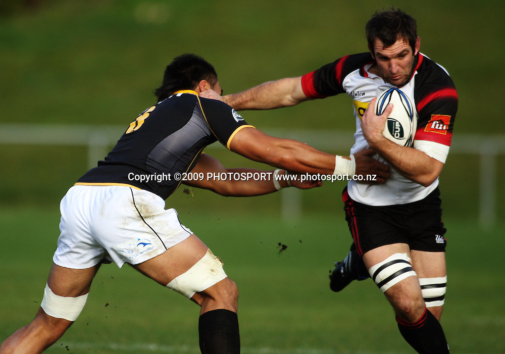 Canterbury captain George Whitelock tries to fend off Victor Vito.<br /> Air NZ Cup preseason rugby match - Wellington Lions v Canterbury at Porirua Park, Porirua, Wellington. Friday 23 July 2009. Photo: Dave Lintott/PHOTOSPORT