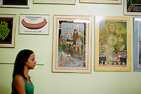 Prints from the annual festival, starting from 1969, line a wall of the main room at the Instituto de Cultural Puertorriqueña, a cultural center in Jayuya, Puerto Rico, on Monday, November 17, 2008. Residents of Jayuya will celebrate the 39th annual Festival Indigena de Jayuya, which honors their Taino Indian heritage, this weekend.