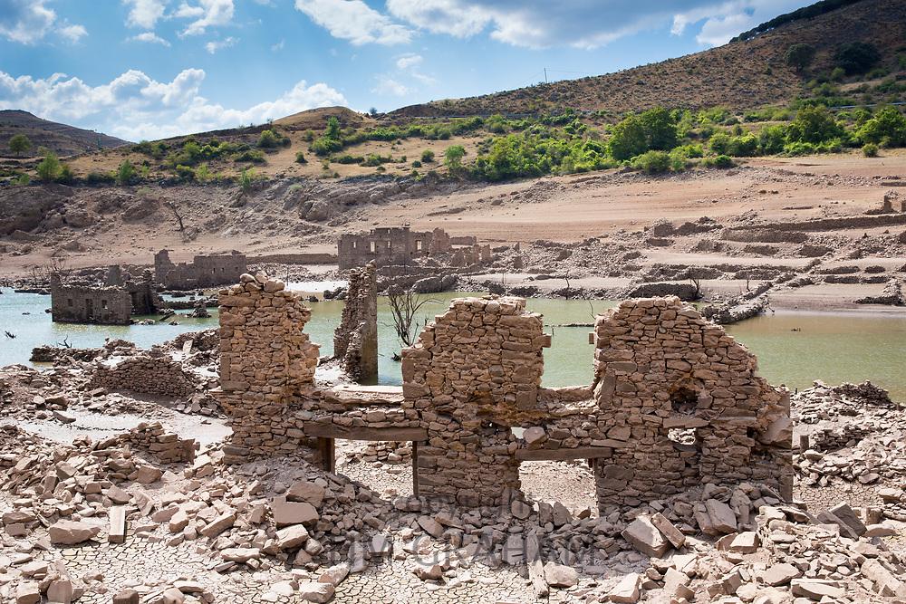 Derelict buildings submerged by flooding when a dam created a reservoir Embalse de Mansilla at Mansilla de la Sierra in La Rioja, Spain