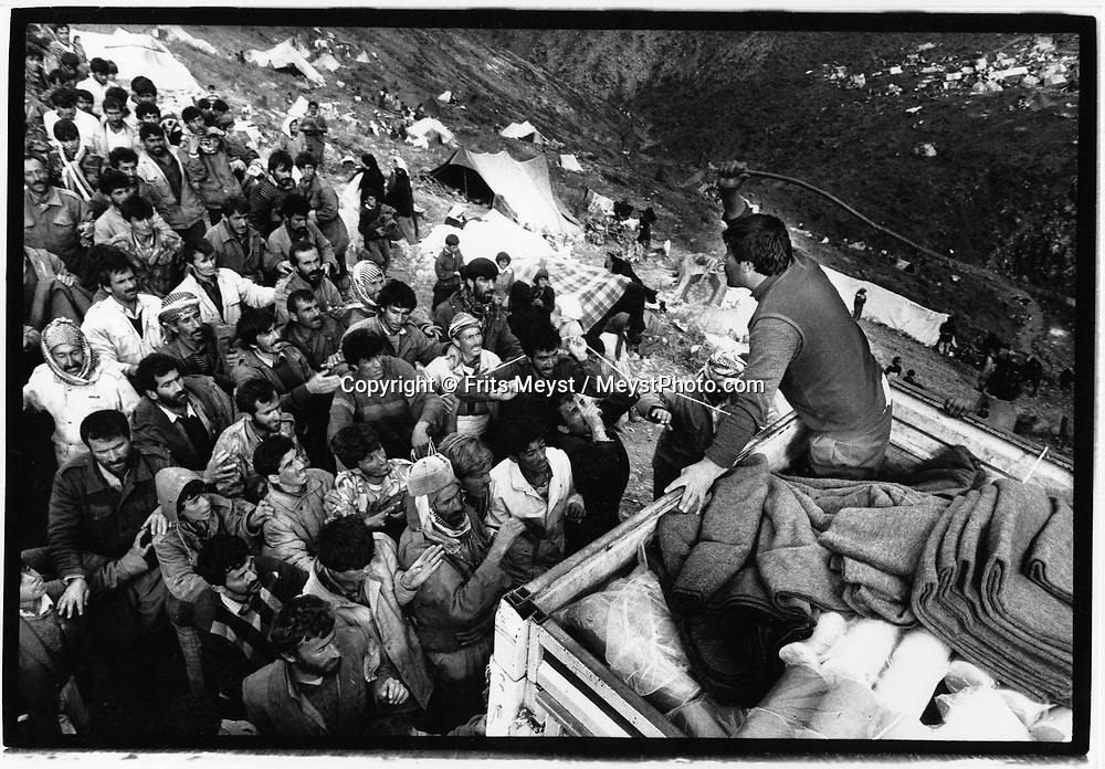 CUKURCA, HAKKARI, TURKEY, 10.04.91. Kurdish refugees arrive in the refugeecamp near Cukurca, after they were attacked by the Iraqi Army during the Kurdish uprising against Saddam Houssein. The revolt occured at the end of the Gulf war when the Iraqi army was thought to be defeated. The refugees walked sometimes barefeet through the snow covered  mountains, to arrive in a camp with no facilities, no food, and no medical attention, and hostile Turkish soldiers. With Saddams soldiers chasing them they were collected in camps on the Turkish border. ©Photo by Frits Meyst/NewsImages<br /><br />fleeing, war, victims, agony, defeated, exhausted, pain, civilians, aid, food, distribution, relief
