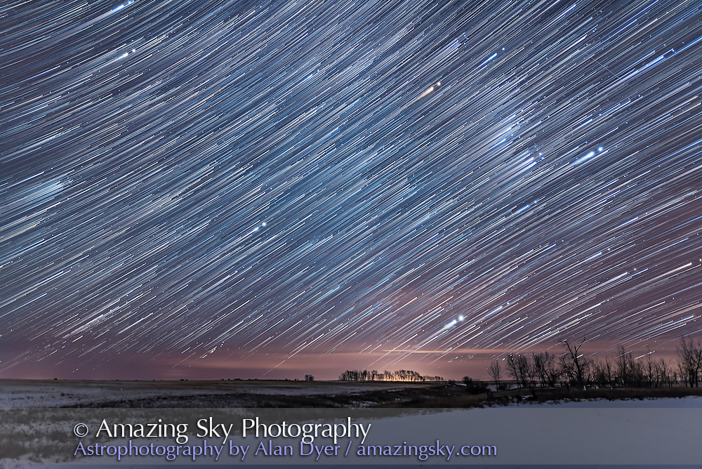 A star trail stack of 350 frames of Orion rising on a January winter night, over about 3 hours. Taken from home in southern Alberta. Sirius is the bright star at bottom above the trees.<br /> <br /> Each exposure is 15 seconds at f/2 with the 24mm Sigma lens and Nikon D750 at ISO 2000. A final exposure taken a minute or so after the main sequence set added the stars at the end of the trails. Stacked with Advanced Stacker Actions in Photoshop.