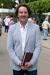 © Licensed to London News Pictures. 19/05/2014. London, England. Irish Garden Designer Diarmuid Gavin. Press Day at the RHS Chelsea Flower Show. On Tuesday, 20 May 2014 the flower show will open its doors to the public.  Photo credit: Bettina Strenske/LNP