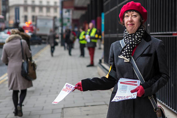 Rachel Brett, handing out leaflets at the British Library picket line. PCS Budget Day Strikes were held all over London, followed by a rally outside the House of Commons. 20th March 2013.
