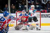KELOWNA, CANADA - FEBRUARY 22: Dillon Dube #19 of the Kelowna Rockets keeps his eye on the puck in front of the net of Patrick Dea #1 of the Edmonton Oil Kings on February 22, 2017 at Prospera Place in Kelowna, British Columbia, Canada.  (Photo by Marissa Baecker/Shoot the Breeze)  *** Local Caption ***
