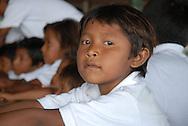 Clases en la Escuela de la Comunidad Warao de Boca de Tigre  en el Delta Amacuro, Venezuela. Este pueblo indígena del oriente del país,  que contaba para 2001 con 36.000 habitantes aproximadamente, construyen sus hogares suspendidos sobre las aguas  para compensar los cambios de marea que vienen del mar del Caribe. Durante los años recientes conviven con la exploración petrolífera, el tráfico de drogas y la actividad turistica se lleva a  cabo actualmente en la zona, en la que habitan desde hace por lo menos 8.000 años. Venezuela,  2006. (Ramón Lepage / Orinoquiaphoto)  Classes in the Warao Comunity school in Boca de Tigre in the Amacuro Delta, Venezuela. This ethnic group of the east of the country, that counted in 2001 with approximate 36.000 inhabitants, constructs their homes suspended on waters to compensate the changes of tide that come from the Caribbean sea. During the recent years they coexist with the petroliferous exploration, the drug traffic and the tourist activity that  are carried out in the zone, in which they have been living for at least 8,000 years. Venezuela, 2006. (Ramon Lepage/Orinoquiaphoto)..