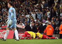 Photo: Rich Eaton.<br /> <br /> Leeds United v Watford. Coca Cola Championship. Play off Final. 21/05/2006.<br /> <br /> Watford players celebrate with a pile up as a dejected keeper Neil Sullivan of Leeds walks off the pitch at the end of the game
