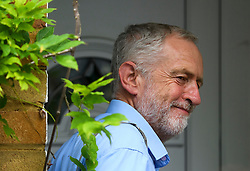 © London News Pictures. 28/07/2016. London, UK. Labour Party leader JEREMY CORBYN smiling as he returns to his London home following a verdict at the Royal Courts of Justice which upheld a decision by the NEC to guarantee Corbyn a place on the Labour Party leadership ballot.  Photo credit: Ben Cawthra/LNP