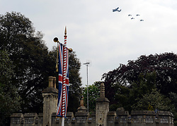 © Licensed to London News Pictures. 19/05/2012. WIndsor, UK Planes file over the Town Gate at Windsor Castle. Armed Forces muster and parade in Windsor today , 19th May 2012, in tribute to Her Majesty the Queen for the Diamond Jubilee. 2,500 troops paraded through the town before the Queen and Duke of Edinburgh to mark the Diamond Jubilee. Once the parade has passed the Queen and Duke traveled along the same route to an arena within Home Park, where the troops mustered. A tri-service flypast of 78 aircraft, including helicopters, Hawks, the Battle of Britain Memorial Flight, the Red Arrows and Tornados went overhead. Photo credit : Stephen Simpson/LNP