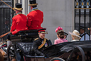 "Kate, Camilla and Harry enter Buckingham Palace - Trooping the Colour by the Irish Guards on the Queen's Birthday Parade. The Queen's Colour is ""Trooped"" in front of Her Majesty The Queen and all the Royal Colonels.  His Royal Highness The Duke of Cambridge takes the Colonel's Review for the first time on Horse Guards Parade riding his horse Wellesley. The Irish Guards are led out by their famous wolfhound mascot Domhnall and more than one thousand Household Division soldiers perform their ceremonial duty. The Soldiers will parade in the traditional ceremonial uniforms of the Household Cavalry, Royal Horse Artillery, and Foot Guards. They are accompanied by the Household Division Bands & Corps of Drums. London 17th June 2017."