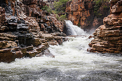 Floodwater cascades over the cliffs at Ruby Falls in Doubtful Bay on the Kimberley coast.