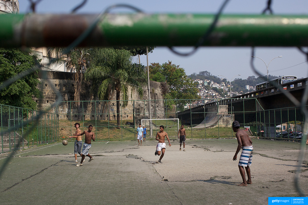 Local boys play football on a run down concrete pitch near the Carnival parade ground in Rio de Janeiro. Rio de Janeiro,  Brazil. 17th September 2010. Photo Tim Clayton.