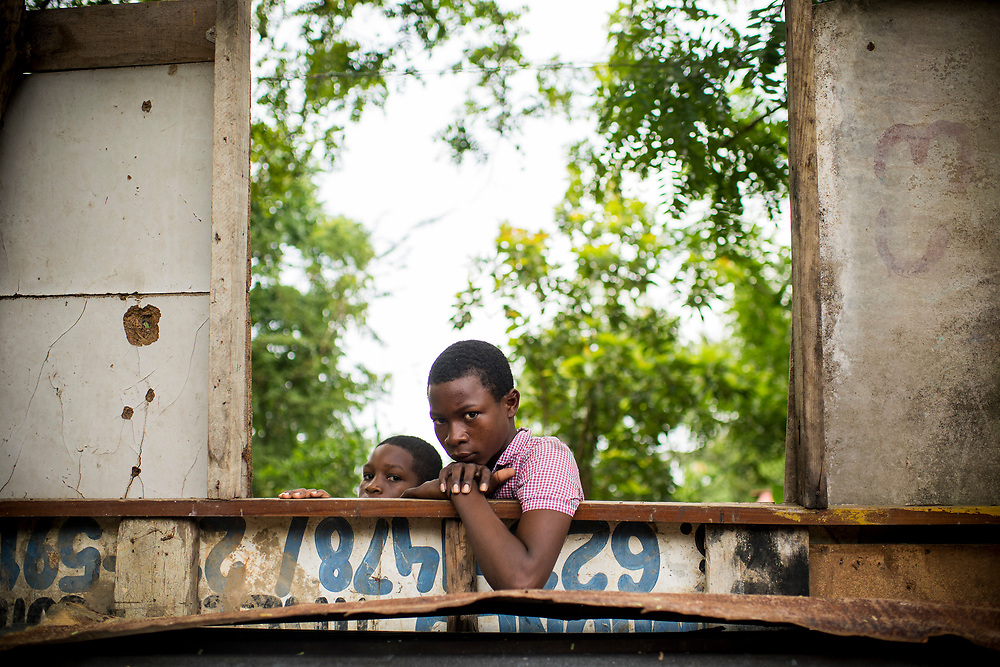 July 19, 2017, Boston, MA:<br /> Two young boys look on in El Mamon during the 2017 Lindos Sue&ntilde;os trip in the Dominican Republic Wednesday, July 19, 2017. <br /> (Photo by Billie Weiss/Boston Red Sox)
