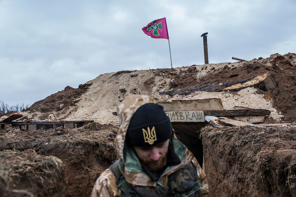 TALAKIVKA, UKRAINE - FEBRUARY 5, 2015: A member of the St. Mary's Battalion, a pro-Ukraine militia, outside a bunker at a front-line encampment in Talakivka, Ukraine. With more than 220 people having died in the past several weeks, a new diplomatic push is underway to bring an end to fighting between pro-Russia rebels and Ukrainian forces. CREDIT: Brendan Hoffman for The New York Times
