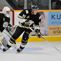 COBOURG, ON - Oct 19: Ontario Junior Hockey League game between Kingston Voyageurs and Trenton Golden Hawks. Loren Ulett #13 of the Trento Golden Hawks skates with the puck during first period game action..(Photo by Shawn Muir / OJHL Images)