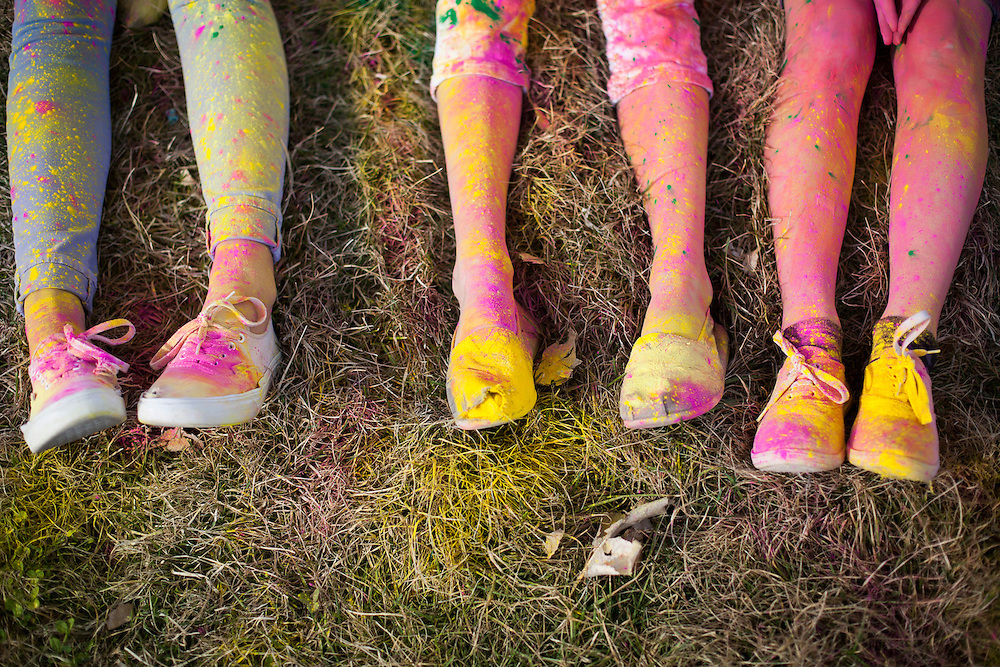 Early arrivers have the luxury of choosing their own decorative colors before massive crowds gather under a plum of various color at the Holi Festival of Colors, on Saturday, Mar. 24, 2012, at the Lotus Temple, in Spanish Fork, Utah. (Photo by Benjamin B. Morris ©2012)