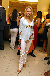 IMOGEN LLOYD WEBBER at a party hosted by Links at their store in Sloane Square, London to celebrate the forthcoming Glorious Goodwood Racing festival held on 26th July 2006.<br />
