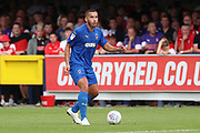 AFC Wimbledon defender Rod McDonald (4) dribbling during the EFL Sky Bet League 1 match between AFC Wimbledon and Rotherham United at the Cherry Red Records Stadium, Kingston, England on 3 August 2019.