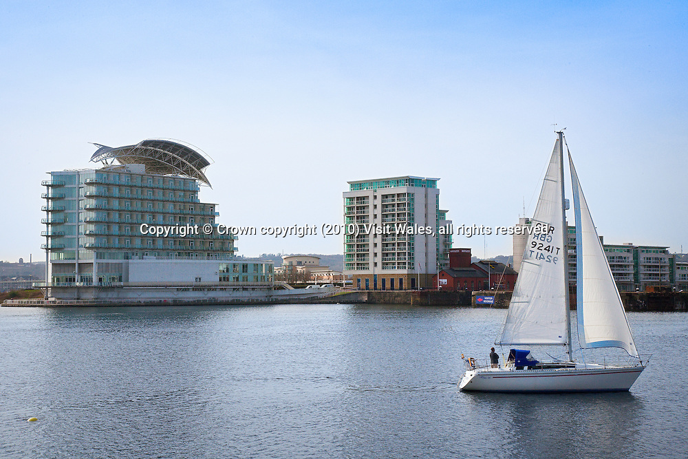 Boat sailing past St David's Hotel<br /> Cardiff Bay<br /> Cardiff<br /> South<br /> Towns And Villages