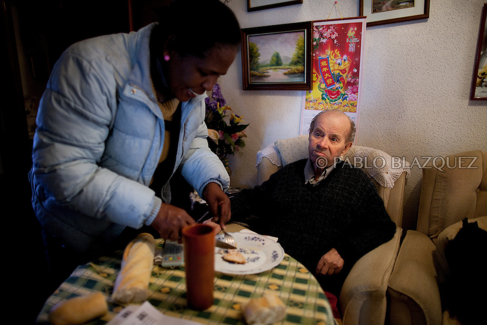 Luisa Pinales, from the Anti-eviction organization, encourages Vicente to eat on April 17 2012 in Madrid, Spain. Spanish Vicente Torres, 73, who is severely ill and underwent a recent heart surgery, and is waiting for a thrombus surgery faces an eviction from his house next April 18th after he endorsed his son, so Citibank would concede a credit to buy a house. His son already handed his house to the bank. Torres has lived at his home for the last 55 years and was paying it for 30 years. Eviction procedures in Spanish courts for unpaid mortgages and rent hit a record of 58,241 in 2011, a 21.2 percent rise over the previous year. Evictions have soared in Spain since the collapse of a property bubble in 2008 that triggered the country's economic crisis.