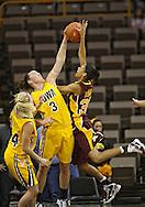 February 10 2011: Iowa Hawkeyes forward Kalli Hansen (3) blocks a shot by Minnesota Golden Gophers guard Kiara Buford (30) during the first half of an NCAA women's college basketball game at Carver-Hawkeye Arena in Iowa City, Iowa on February 10, 2011. Iowa defeated Minnesota 64-62.