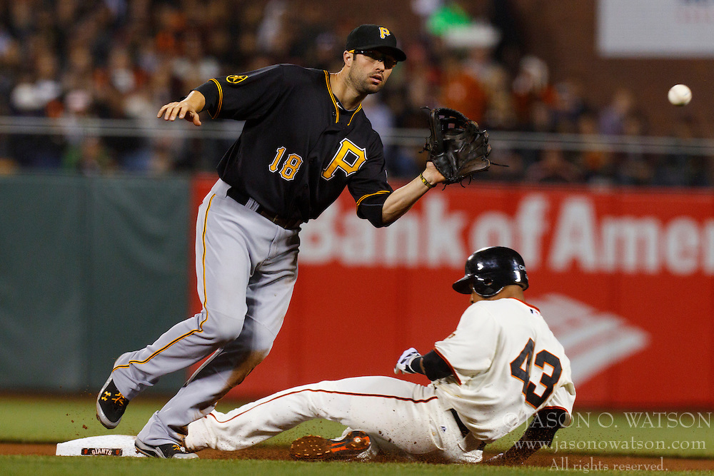 August 9, 2011; San Francisco, CA, USA;  San Francisco Giants shortstop Orlando Cabrera (43) steals second base ahead of a throw to Pittsburgh Pirates second baseman Neil Walker (18) during the seventh inning at AT&T Park.