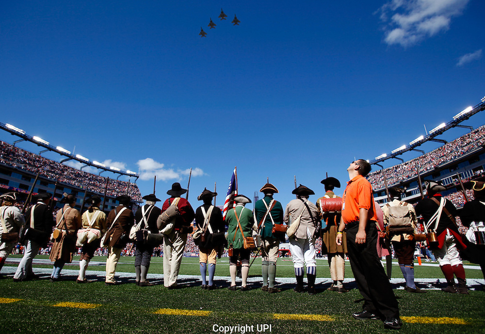 A Gillette Stadium security detail watches jets flown by the Massachusetts Air National Guard as they perform a fly over of the stadium before the game between the Arizona Cardinals and New England Patriots in Foxboro, Massachusetts on September 16, 2012.  The Cardinals defeated the Patriots 20-18. UPI/Matthew Healey