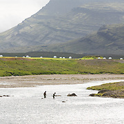 Anglers at the pool Möggusteinn on the river Breiðdalsá, Iceland.