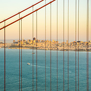 San Francisco skyline thru Golden Gate Bridge in San Francisco, CA.