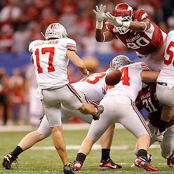January 4, 2011; New Orleans, LA, USA;  Arkansas Razorbacks defensive end Colton Miles-Nash (90) blocks a punt by Ohio State Buckeyes punter Ben Buchanan (17) during the fourth quarter of the 2011 Sugar Bowl at the Louisiana Superdome.Ohio State defeated Arkansas 31-26. Mandatory Credit: Derick E. Hingle