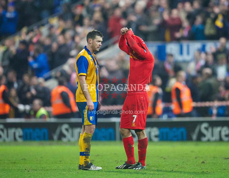 MANSFIELD, ENGLAND - Sunday, January 6, 2013: Liverpool's Luis Alberto Suarez Diaz swaps shirts with Mansfield Town's John Dempster after the FA Cup 3rd Round match at Field Mill. (Pic by David Rawcliffe/Propaganda)