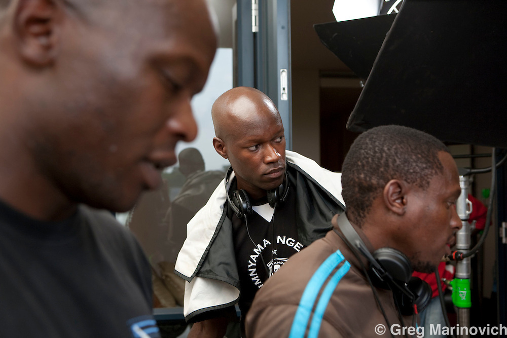 """The shooting of the South African film """"How to steal 2 million"""" in a plush Sandton apartment complex by the Vundla father (Mfundi) and son (Charlie) team . The actress is Hlubi Moboya and the actors are Menzi Ngubane and Rapulane Seipemo. The eleveator has a ingerprint recognition system. Photo Greg Marinoviuch"""