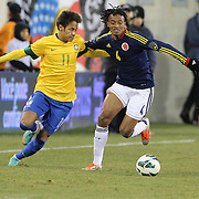 Neymar, Brazil, challenges Juan Guillermo Cuadrado, Colombia, during the Brazil V Colombia International friendly football match at MetLife Stadium, New Jersey. USA. 14th November 2012. Photo Tim Clayton