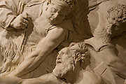 Close up photograph of a wall sculpture from the Richelieu Wing of the Louvre Museum.