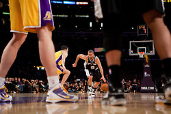 8 February 2010: Guard Tony Parker of the San Antonio Spurs drives to the basket while being guarded by Jordan Farmar of the Los Angeles Lakers during the first half of the Lakers 101-89 victory over the Spurs at the STAPLES Center in Los Angeles, CA. UK ONLY