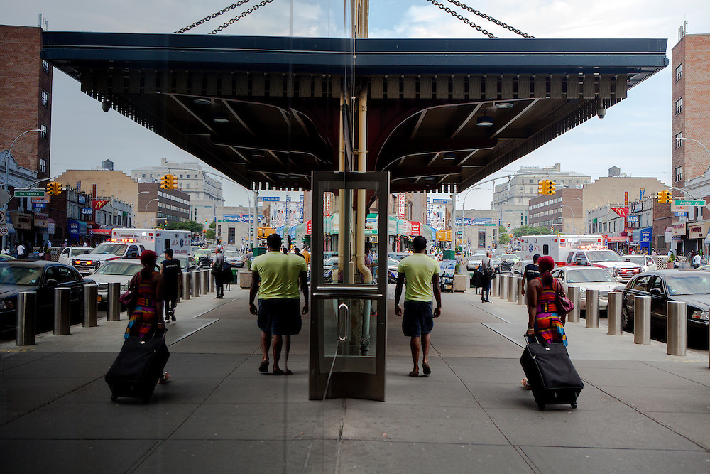 QUEENS, N.Y. - JULY 13, 2015: Travelers walk through Sutphin Boulevard near the corner of Archer Avenue. A property at the corner is part of a plot that is set to be redeveloped called The Crossing at Jamaica Center. CREDIT: Sam Hodgson for The New York Times
