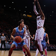 05 December 2018: San Diego State Aztecs forward Jalen McDaniels (5) defends San Diego Toreros guard Tyler Williams (1) under the basket in the first half. The Aztecs lost to the Toreros 73-61 at Viejas Arena.