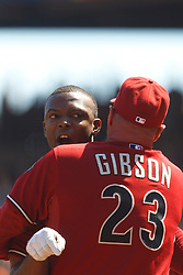 September 4, 2011; San Francisco, CA, USA;  Arizona Diamondbacks right fielder Justin Upton (left) is restrained by manager Kirk Gibson (center) while arguing with MLB umpire Brian Knight (not pictured) after being ejected during the fourth inning against the San Francisco Giants at AT&T Park.