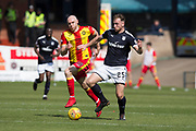 12th May 2018, Dens Park, Dundee, Scotland; Scottish Premier League football, Dundee versus Partick Thistle; Dan Jefferies on Dundee goes past Conor Sammon of Partick Thistle
