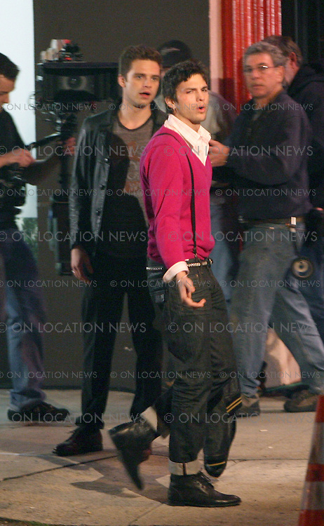 HOLLYWOOD, CALIFORNIA - Wednesday 27th February 2008.***EXCLUSIVE***: .Ashton Kutcher shooting scenes for his latest movie 'Spread'. Kutcher filmed scenes outside The Seventh Veil Strip Club on Sunset Blvd . In the scene Ashton gets in to a heated argument with an unidentified actor Photograph: David Buchan / Leigh Green / On Location News. Sales: Eric Ford 1/818-613-3955 info@OnLocationNews.com