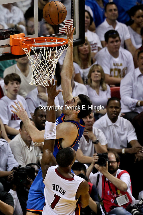 Jun 19, 2012; Miami, FL, USA; Oklahoma City Thunder power forward Nick Collison (4) shoots over Miami Heat power forward Chris Bosh (1) during the second quarter in game four in the 2012 NBA Finals at the American Airlines Arena. Mandatory Credit: Derick E. Hingle-US PRESSWIRE