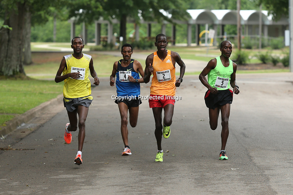Runners Josphat Chobei, Teferi Regasa, Hillary Too and Paul Sugut, stay together as they run on Marshall Sreet during the 40th Gum Tree 10K in Tupelo on Saturday morning.