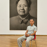 MILAN, ITALY - JULY 06:   Chinese artist Zhang Huan poses in front of Mao Portrait n1  at the opening of the Exhibition 'Zhang Huan: Ashman' at the Padiglione Arte Contemporanea of Milan on July 6, 2010 in Milan, Italy. Zhang Huan: Ashman is  an exhibition of 42 of Huan's works, coming from international collections and dating from the early nineties to the most recent realized with ash....***Agreed Fee's Apply To All Image Use***.Marco Secchi /Xianpix. tel +44 (0) 207 1939846. e-mail ms@msecchi.com .www.marcosecchi.com