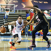 Delaware 87ers Guard Bo Spencer (21) drives by Erie BayHawks defender Guard Scott Suggs (15) in the first half of a NBA D-league regular season basketball game between the Delaware 87ers (76ers) and the Erie BayHawks (Knicks) Tuesday, Feb. 11, 2014 at The Bob Carpenter Sports Convocation Center, Newark, DE