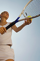 Tennis Player holding ball and racket Preparing to Serve low angle view
