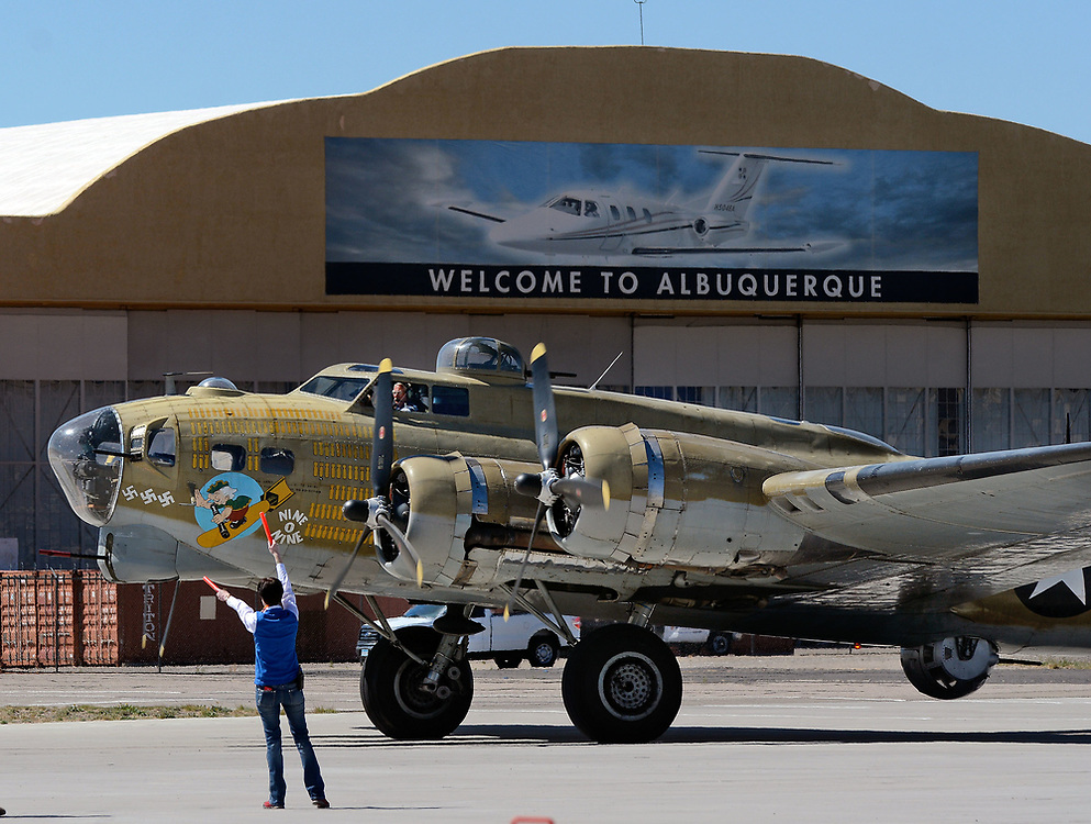 jt040517i/a sec/jim thompson/ Valet parking for the B-17 Flying Fortress as it pulls into the Cutter Aviation tarmac as part of the Wings of Freedom Tour is in Albuquerque Wednesday April 5th-7th.  April 05, 2017. (Jim Thompson/Albuquerque Journal)