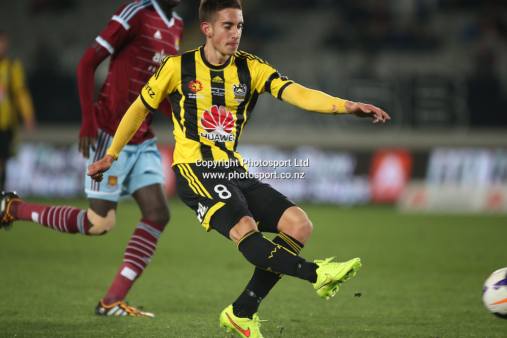 Alejandro Rodriguez of the Wellington Phoenix strikes for his goal during the Wellington Phoenix vs West Ham United football match played at Eden Park in Auckland on 23 July 2014. <br /> Credit; Peter Meecham/ www.photosport.co.nz