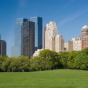 Sheep Meadow in Central Park, New York City with the Time Warner Center and Central Park West apartment buildings in the background