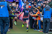 Darcy Graham (#15) of Edinburgh Rugby runs onto the field before the Guinness Pro 14 2018_19 match between Edinburgh Rugby and Ulster Rugby at the BT Murrayfield Stadium, Edinburgh, Scotland on 12 April 2019.