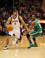 Jan. 28, 2011; Phoenix, AZ, USA; Phoenix Suns forward Jared Dudley (3) handles the ball against the Boston Celtics guard Rajon Rondo (9) at the US Airways Center. The Suns defeated the Celtics 88-71. Mandatory Credit: Jennifer Stewart-US PRESSWIRE.
